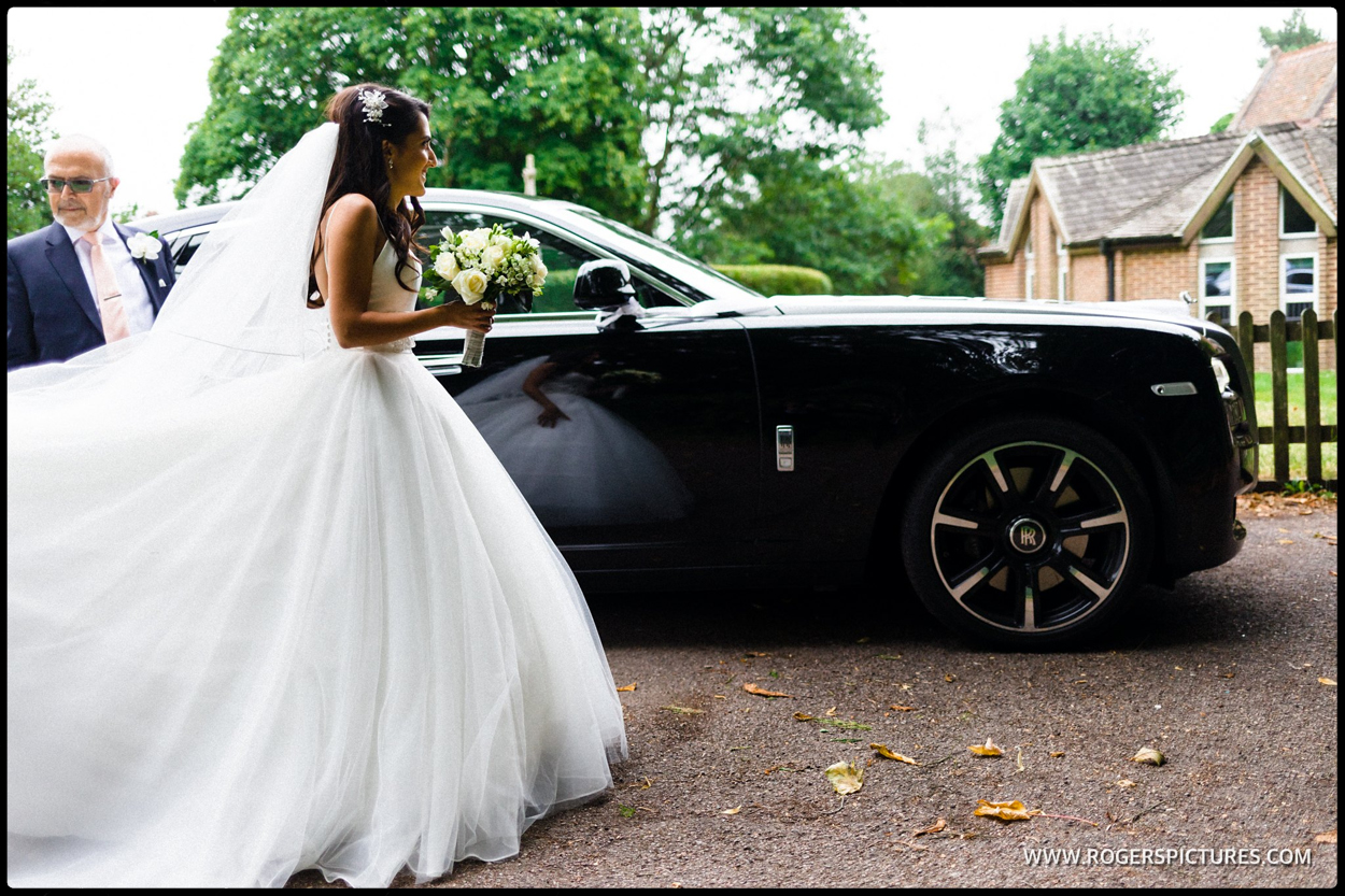 Bride arrives for a Greek wedding in a Rolls Royce