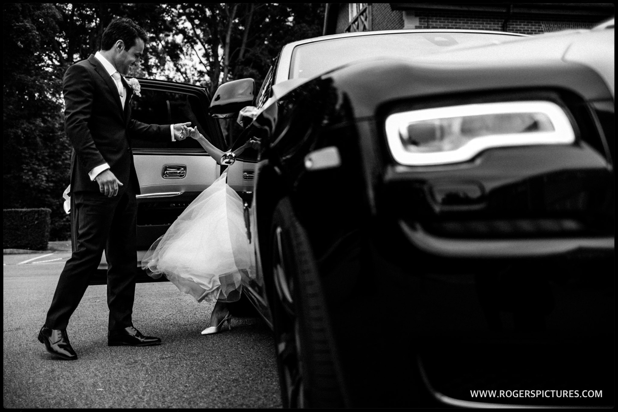 Bride arrives in a Rolls Royce at Luton Hoo