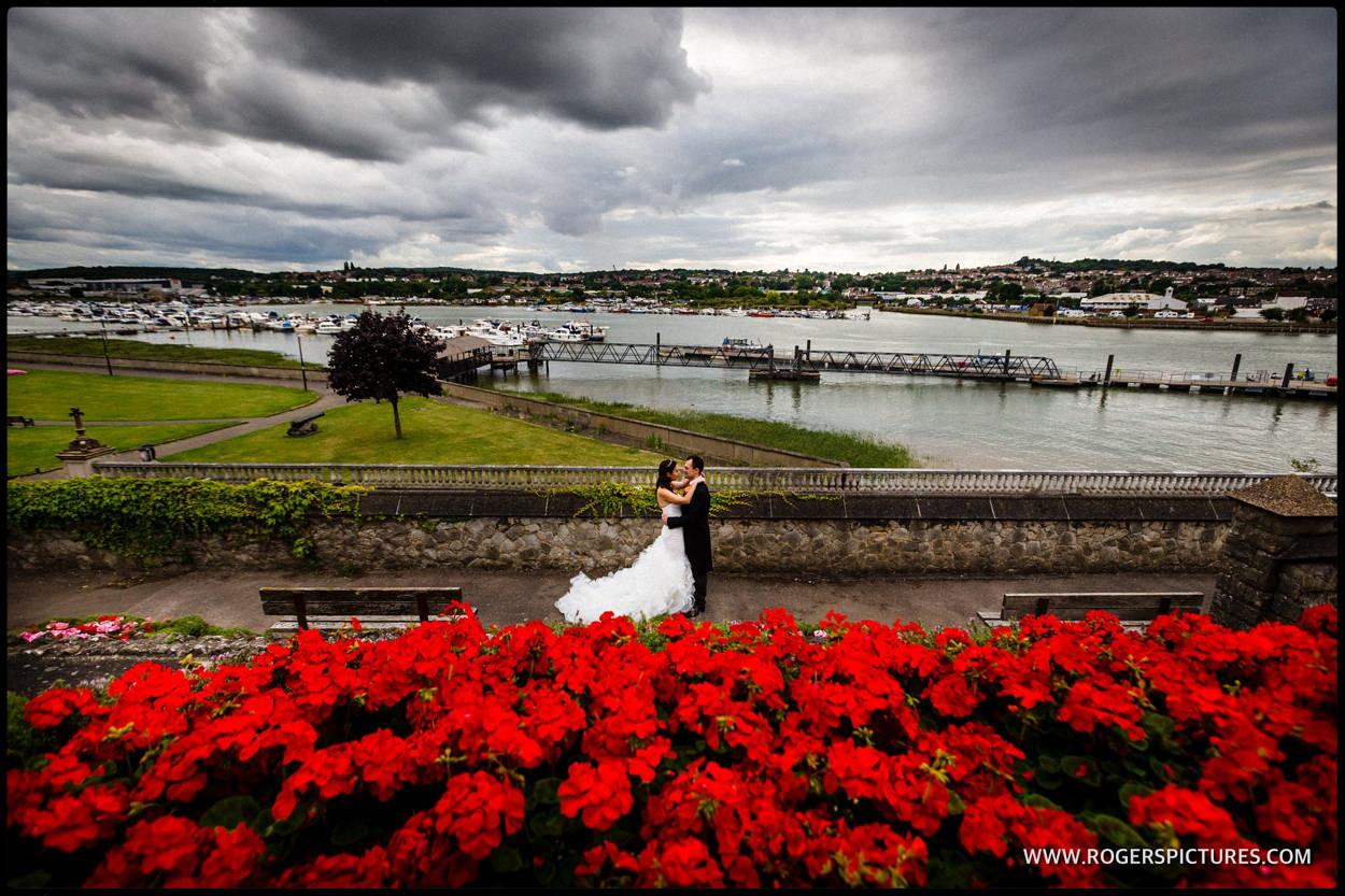 Photo of bride and groom overlooking the estuary at Rochester, Kent