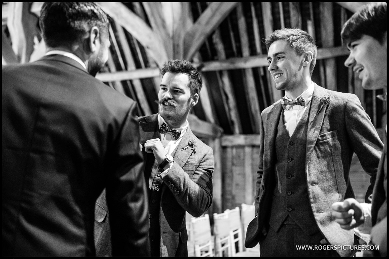 Groom and groomsmen in the Priory Barn Little Wymondley before the wedding starts