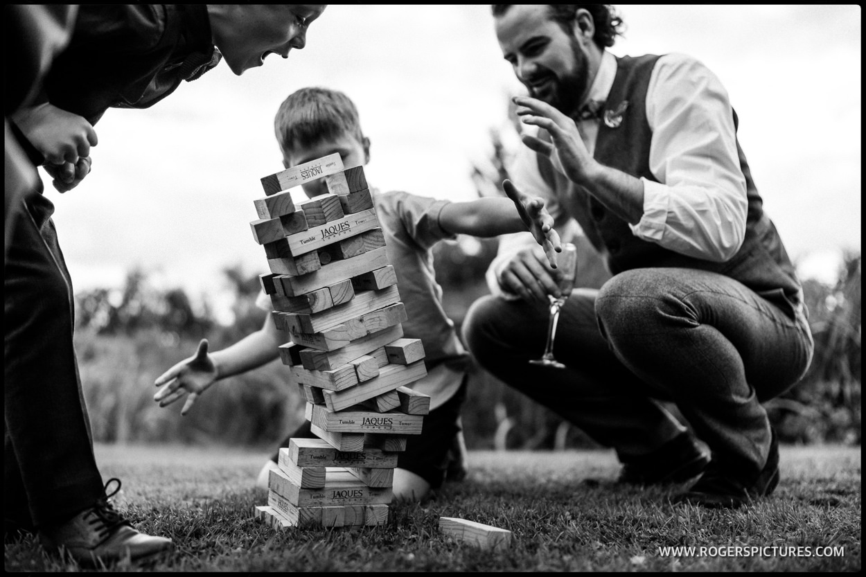 Jenga being played at a Summer wedding reception