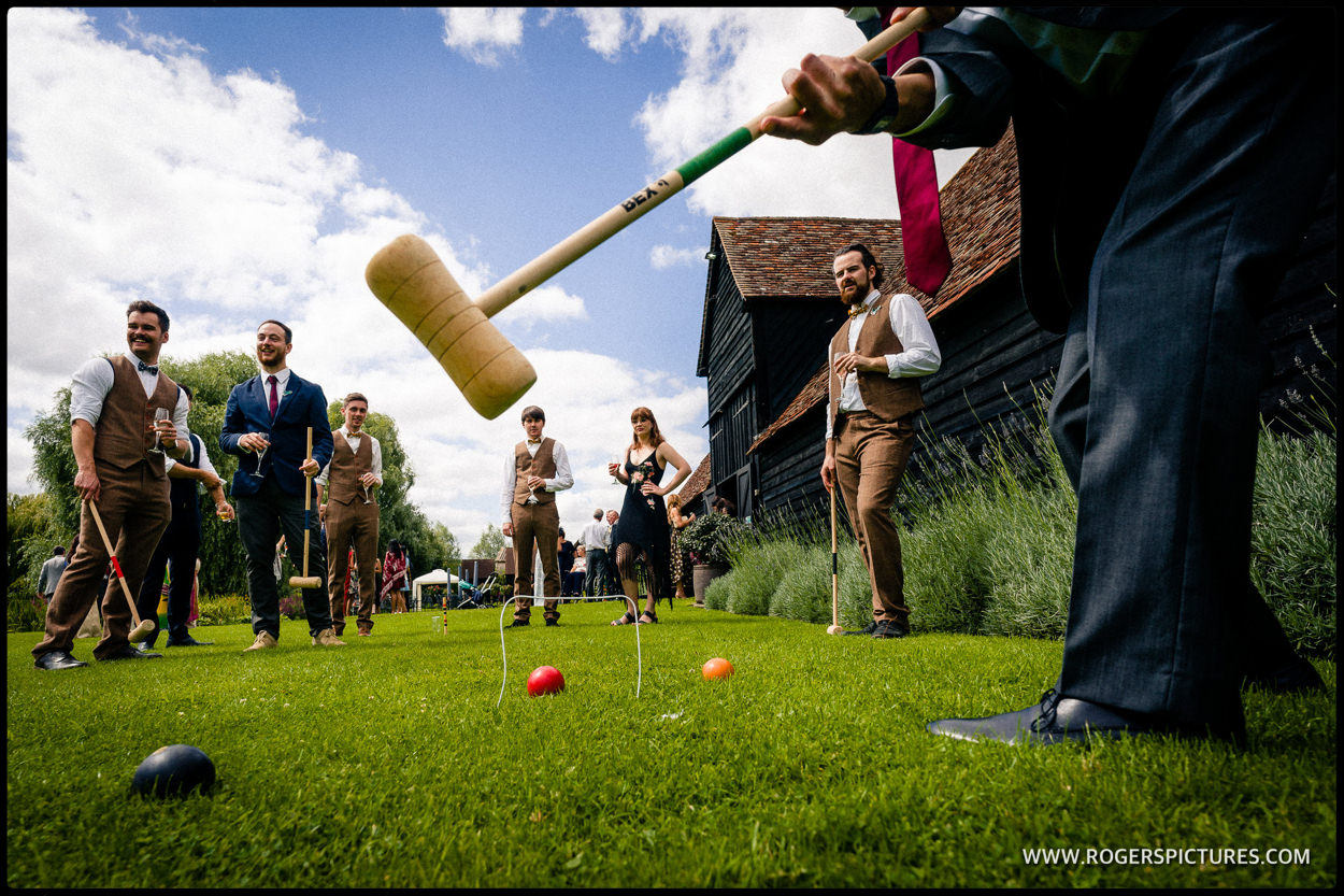 Croquet on the lawn of Priory Barn during a wedding reception
