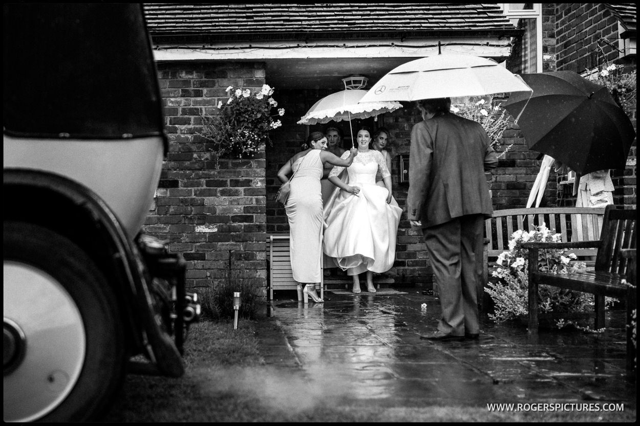Bride in rain before her wedding