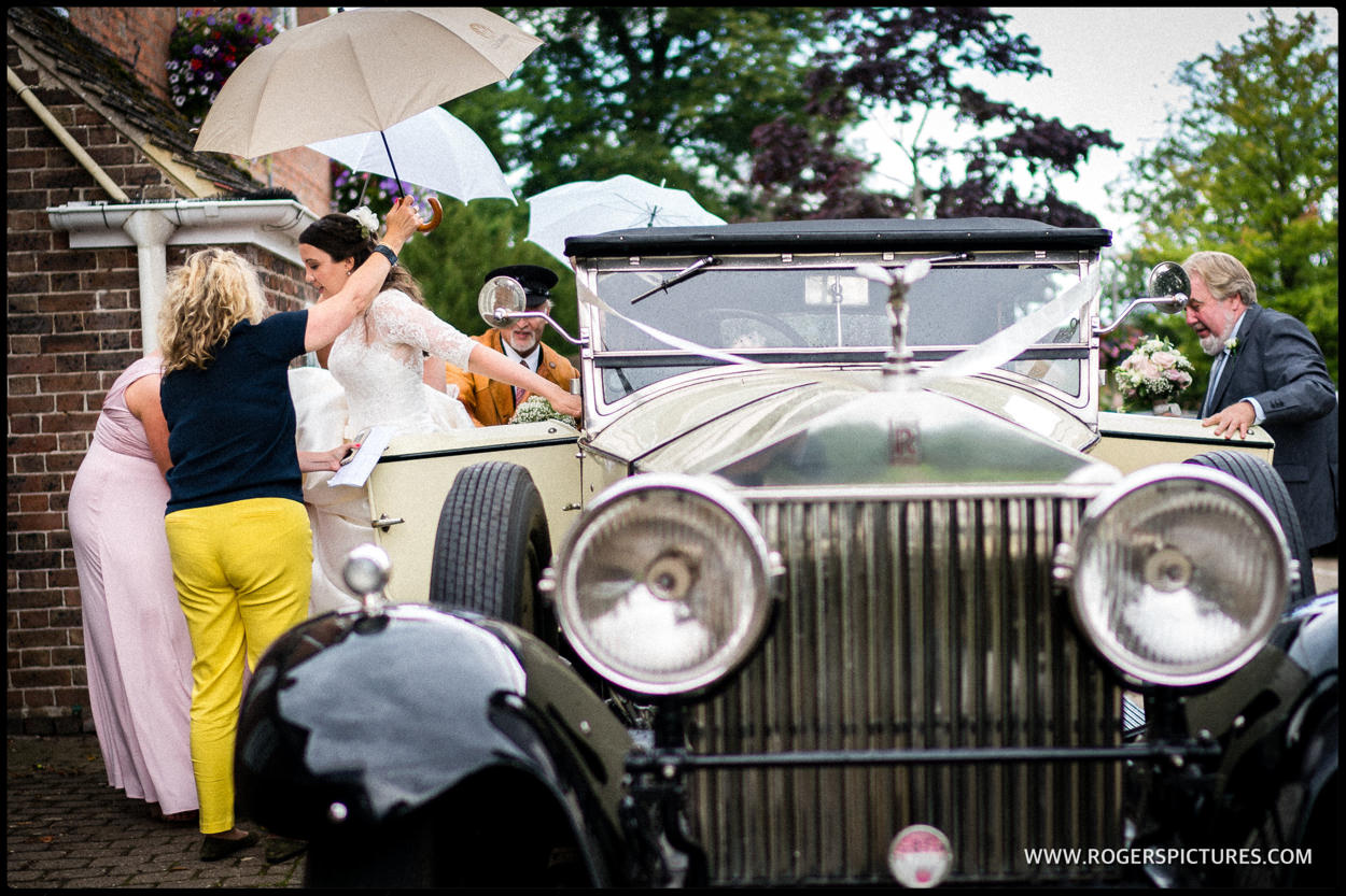Rolls Royce wedding car in the rain