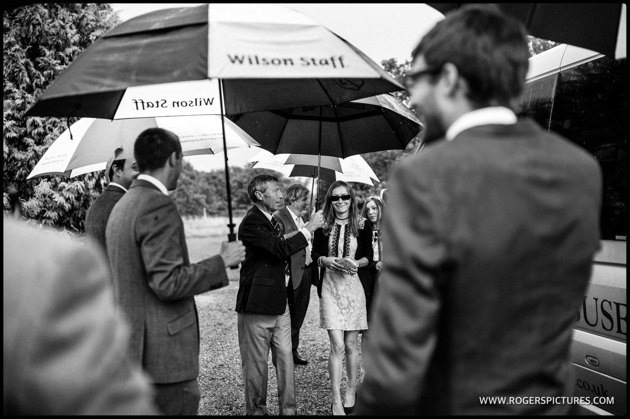 Rain at a Surrey garden wedding reception
