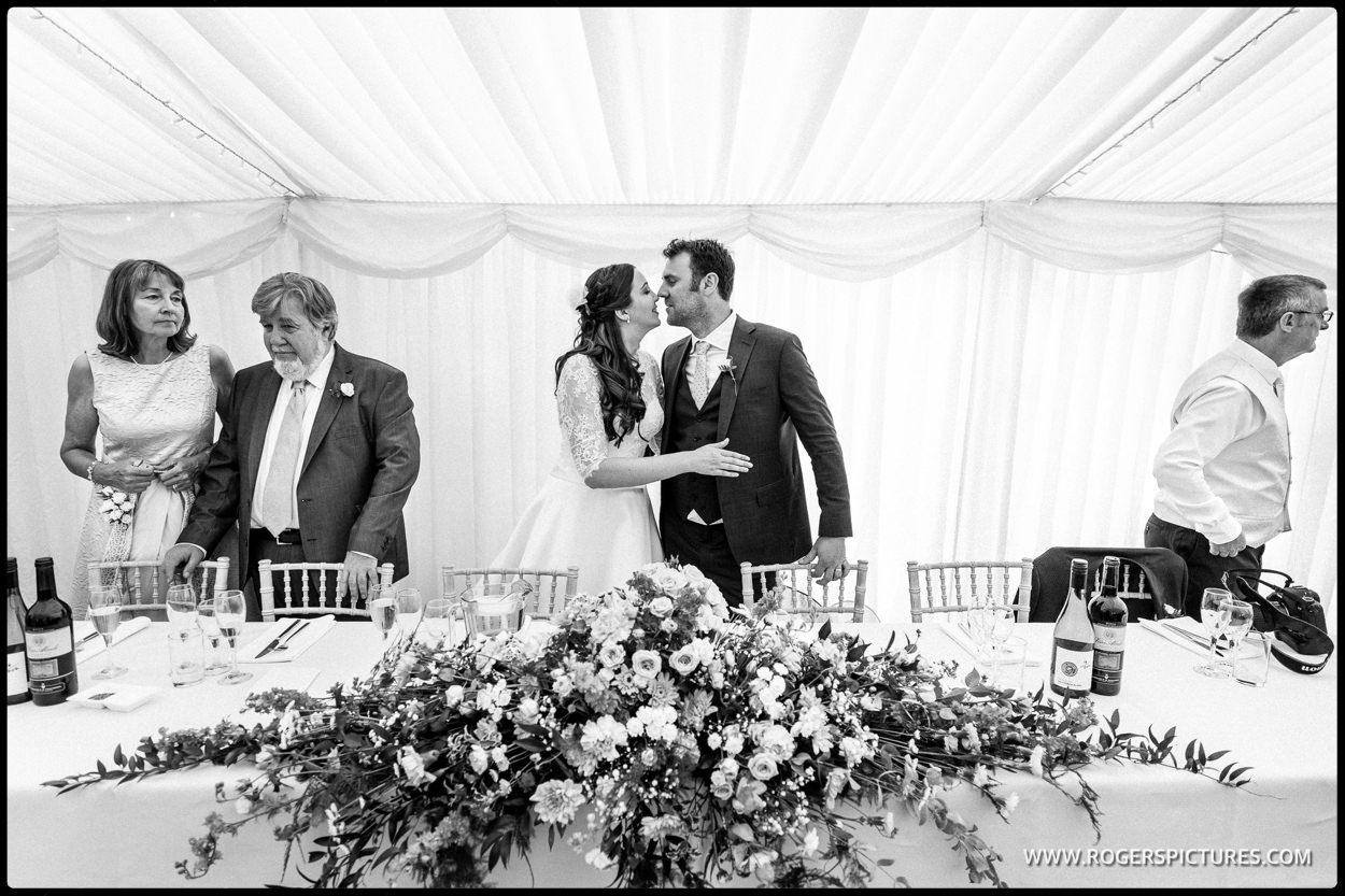 Wedding reception in a garden marquee