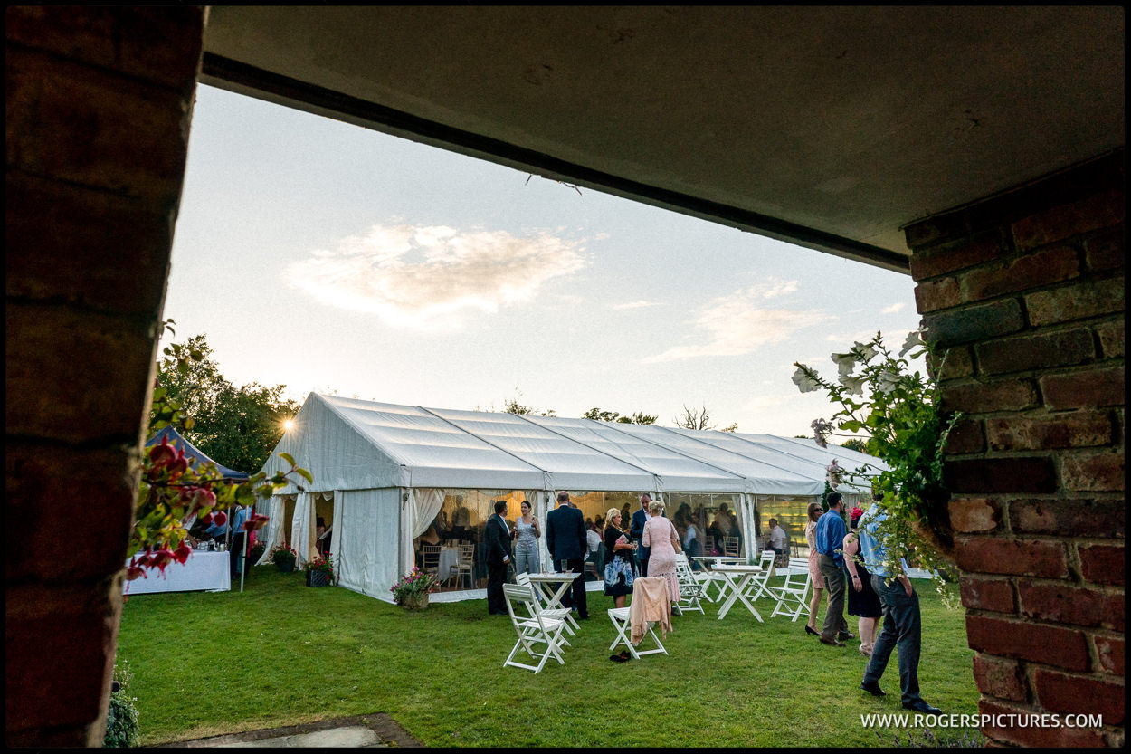 Wedding in a marquee tent in a Surrey garden