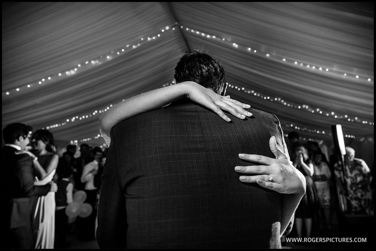 Black and white picture of the first dance at a marquee wedding