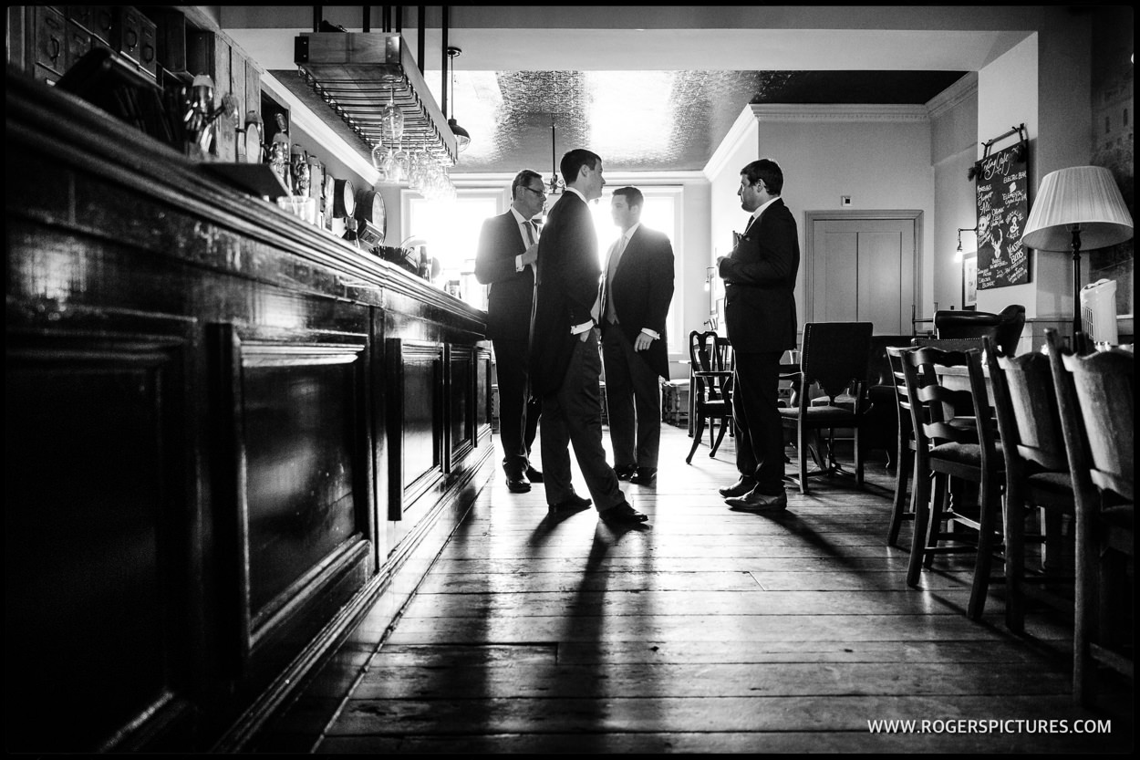 Groomsmen having a quick drink in Bath before the wedding ceremony