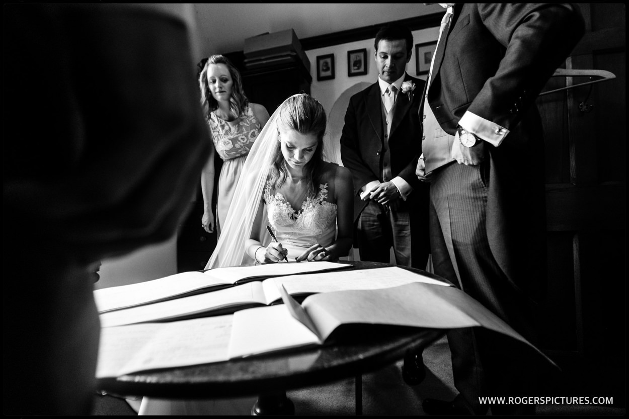 Signing the register at a wedding in Bath