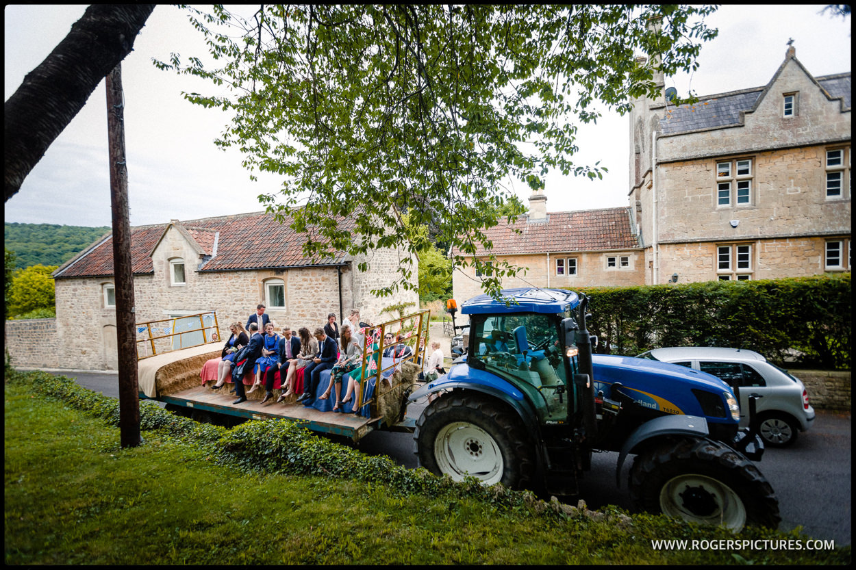 Wedding guests on a tractor trailer