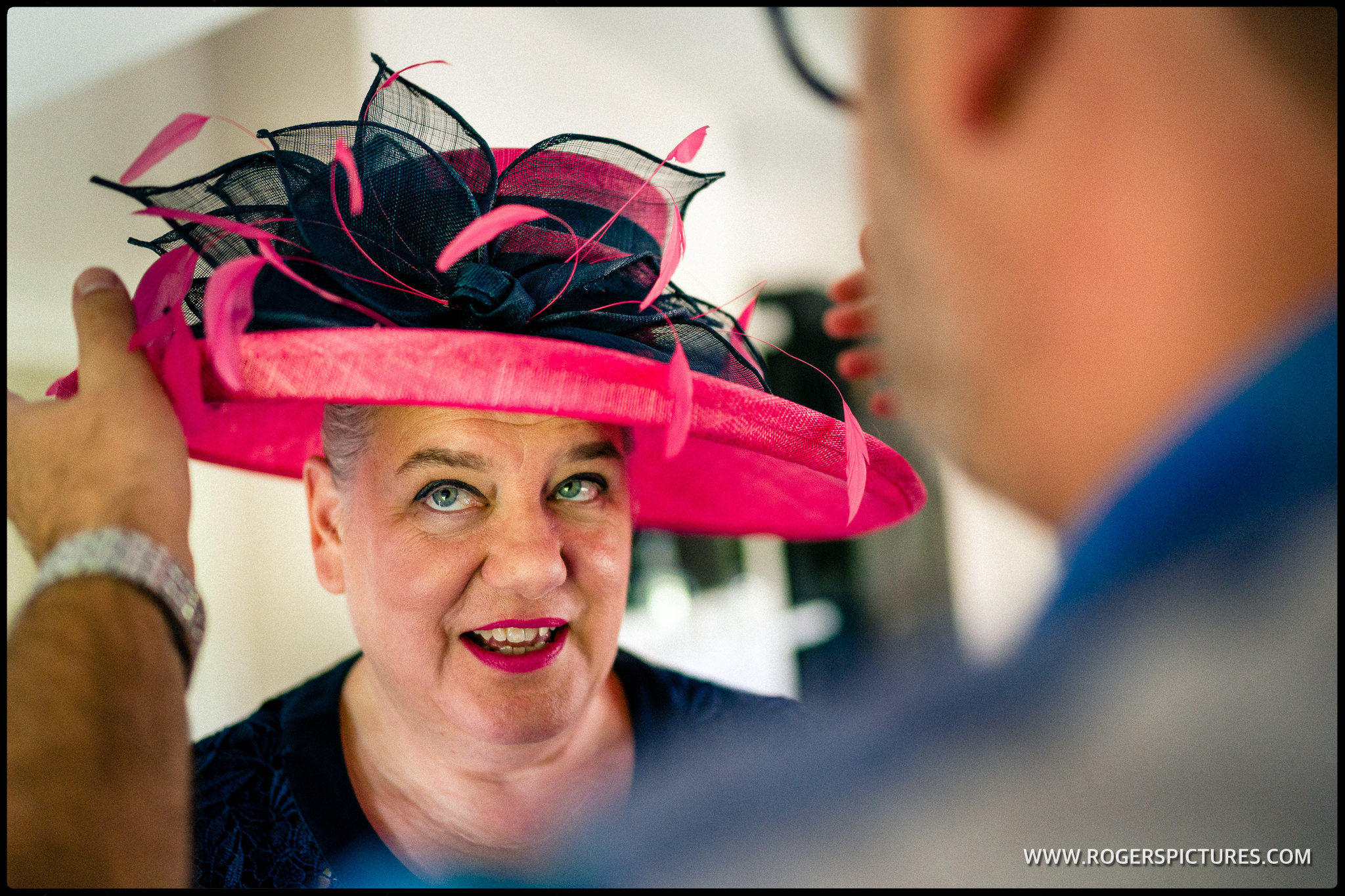 Mother of the groom in a red hat