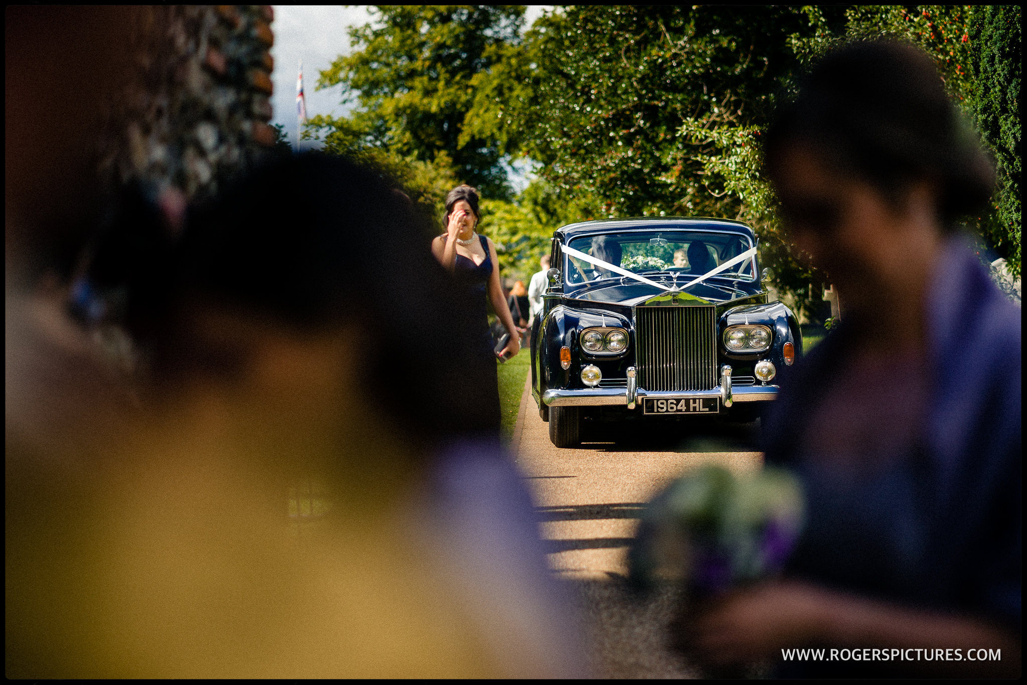 Rolls Royce arriving at St Albans Abbey wedding