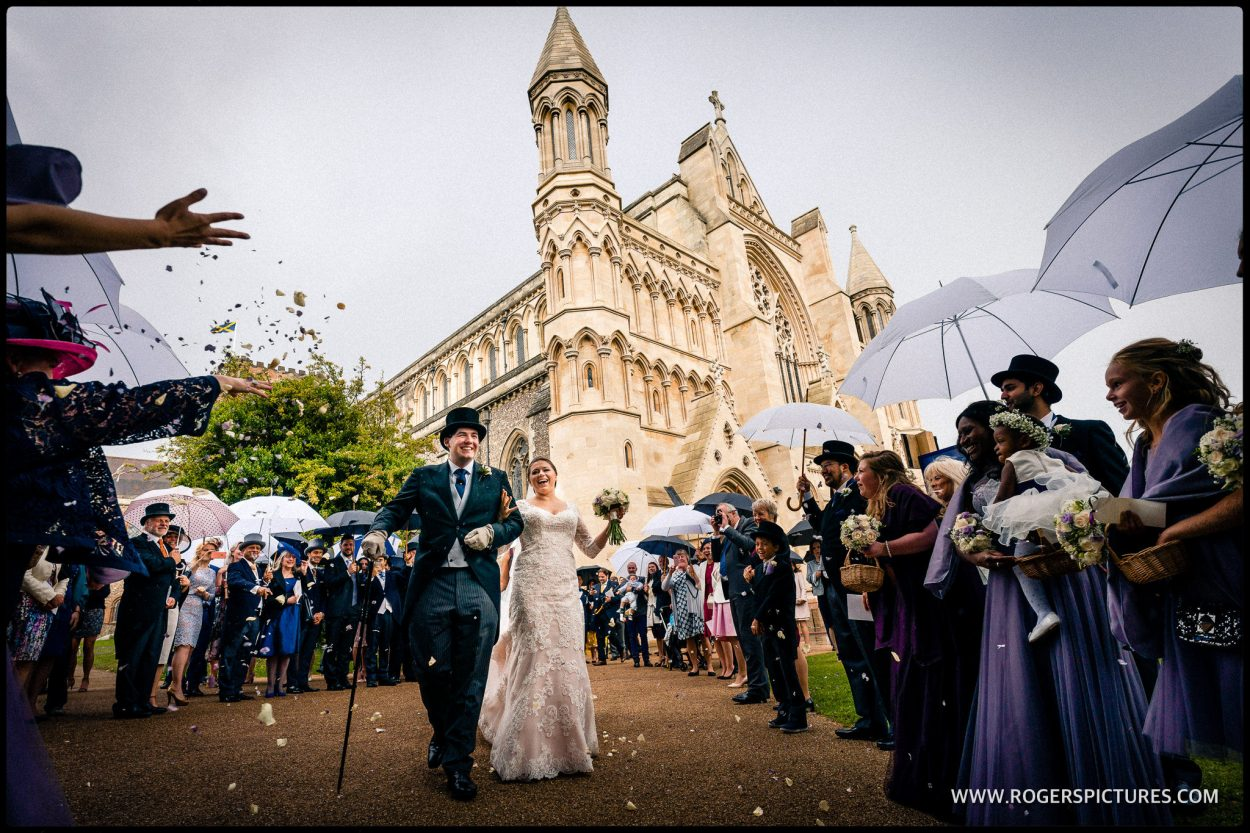 Newly married couple outside St Albans Abbey