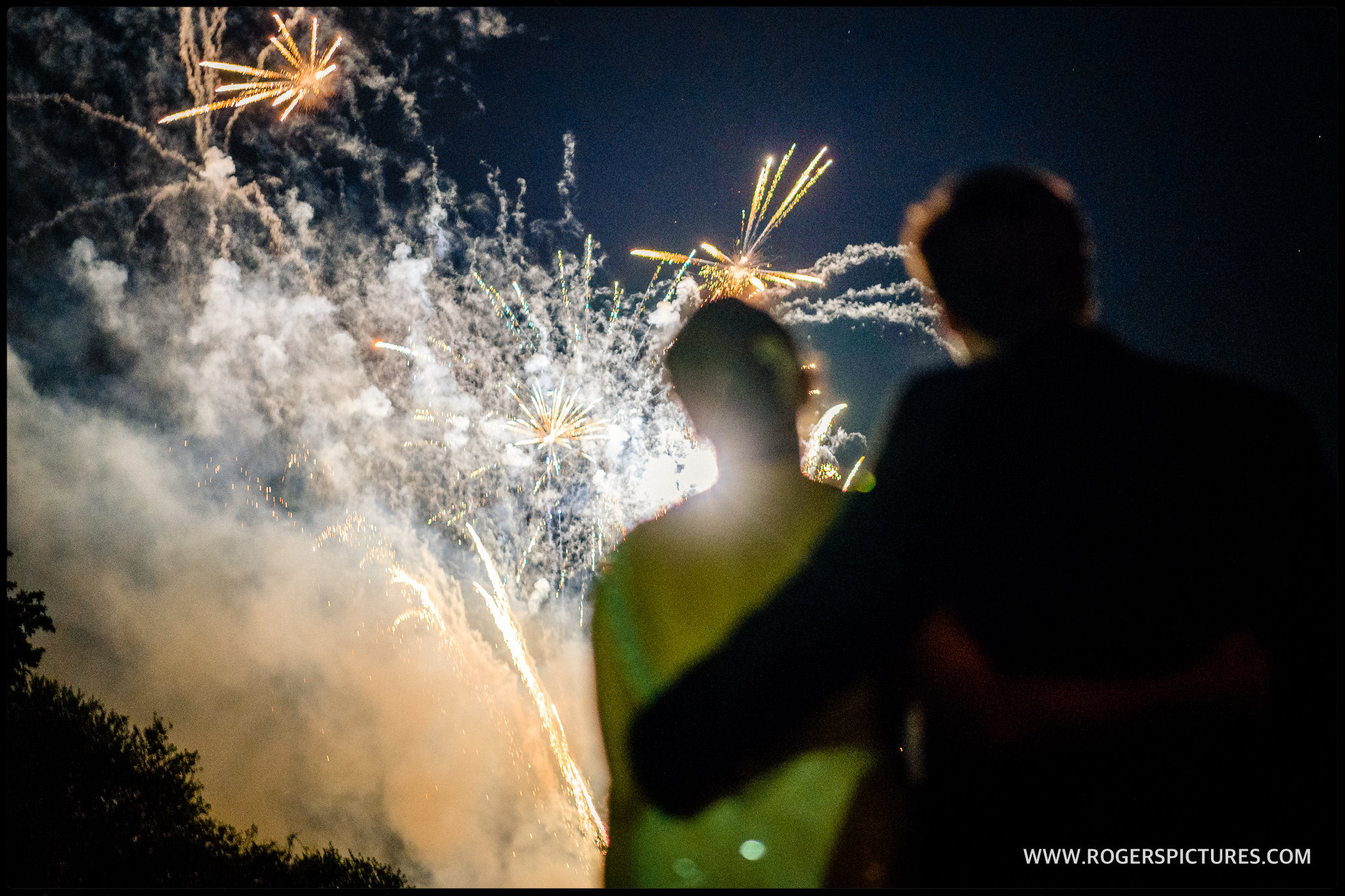 Bride and groom and fireworks at Wrotham Park wedding