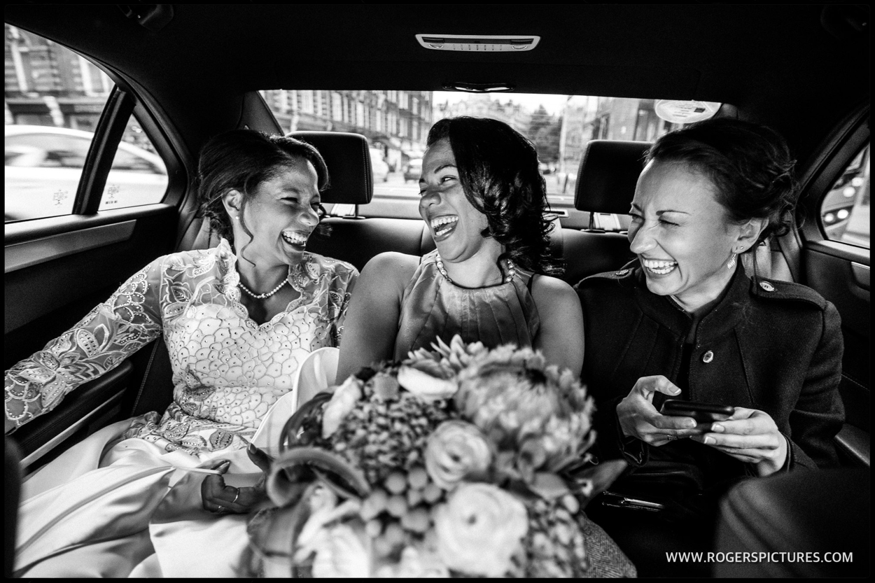 Bride and bridesmaids in an Uber on the way to Westminster wedding