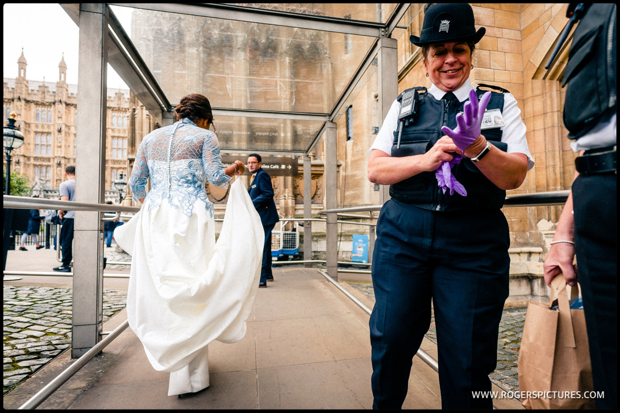 Bride passes police security at House of Commons Wedding