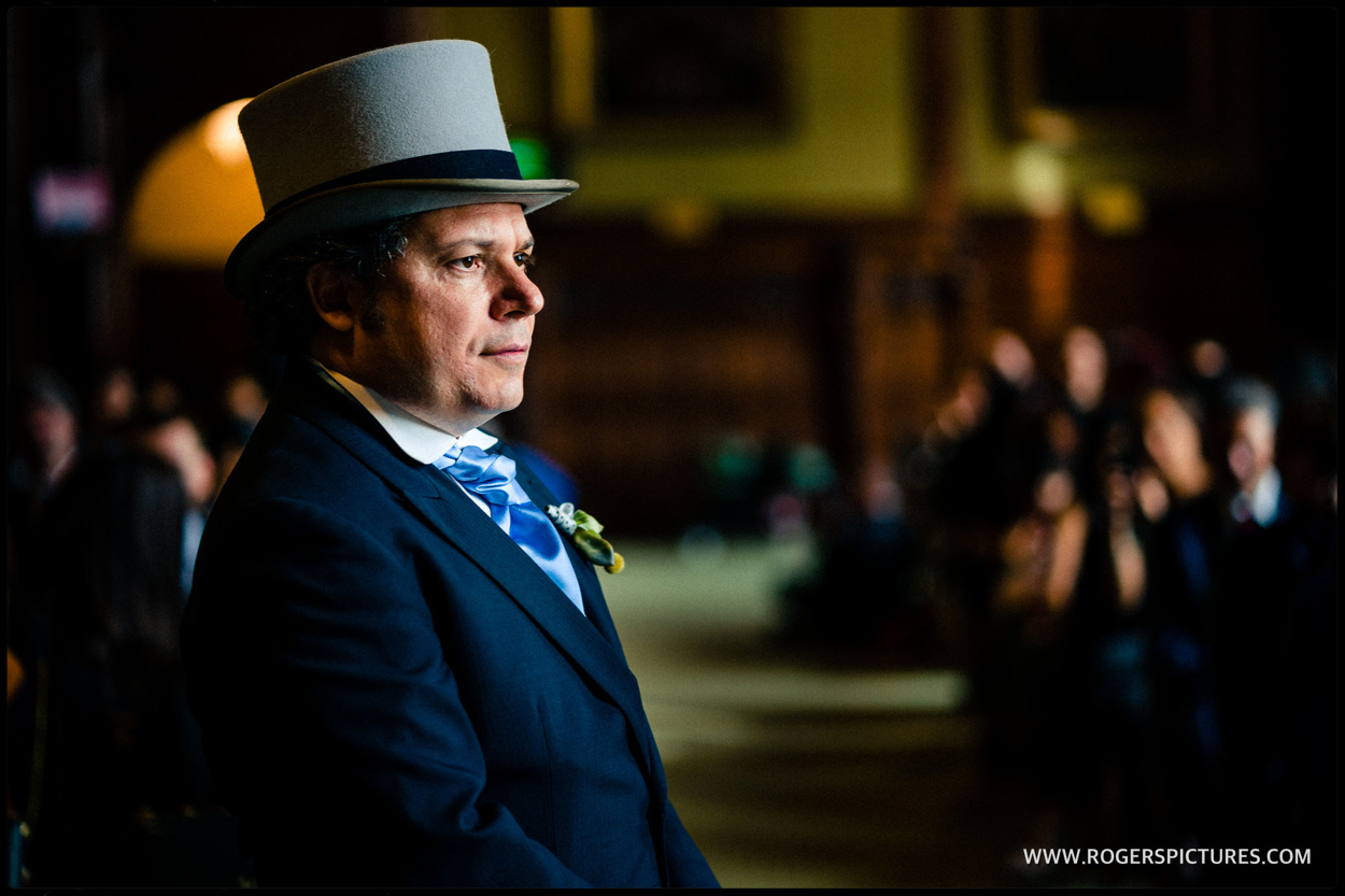 Groom in top hat in the Members Restaurant at Parliament