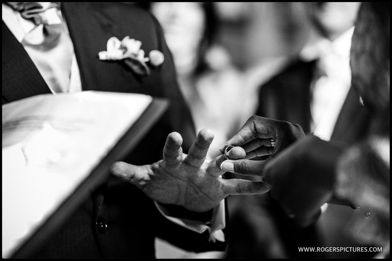 Exchange of wedding rings at a wedding in the Houses of Parliament