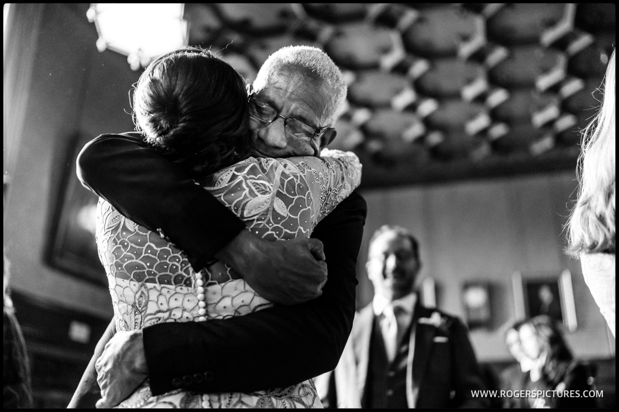 Father hugs his daughter after a wedding ceremony