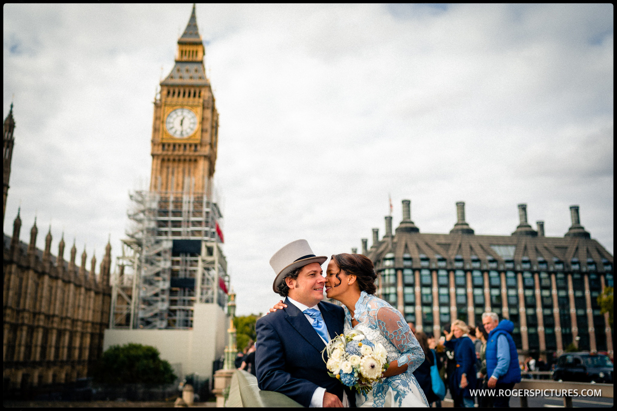 Newly married couple on Westminster Bridge with Big Ben and Parliament