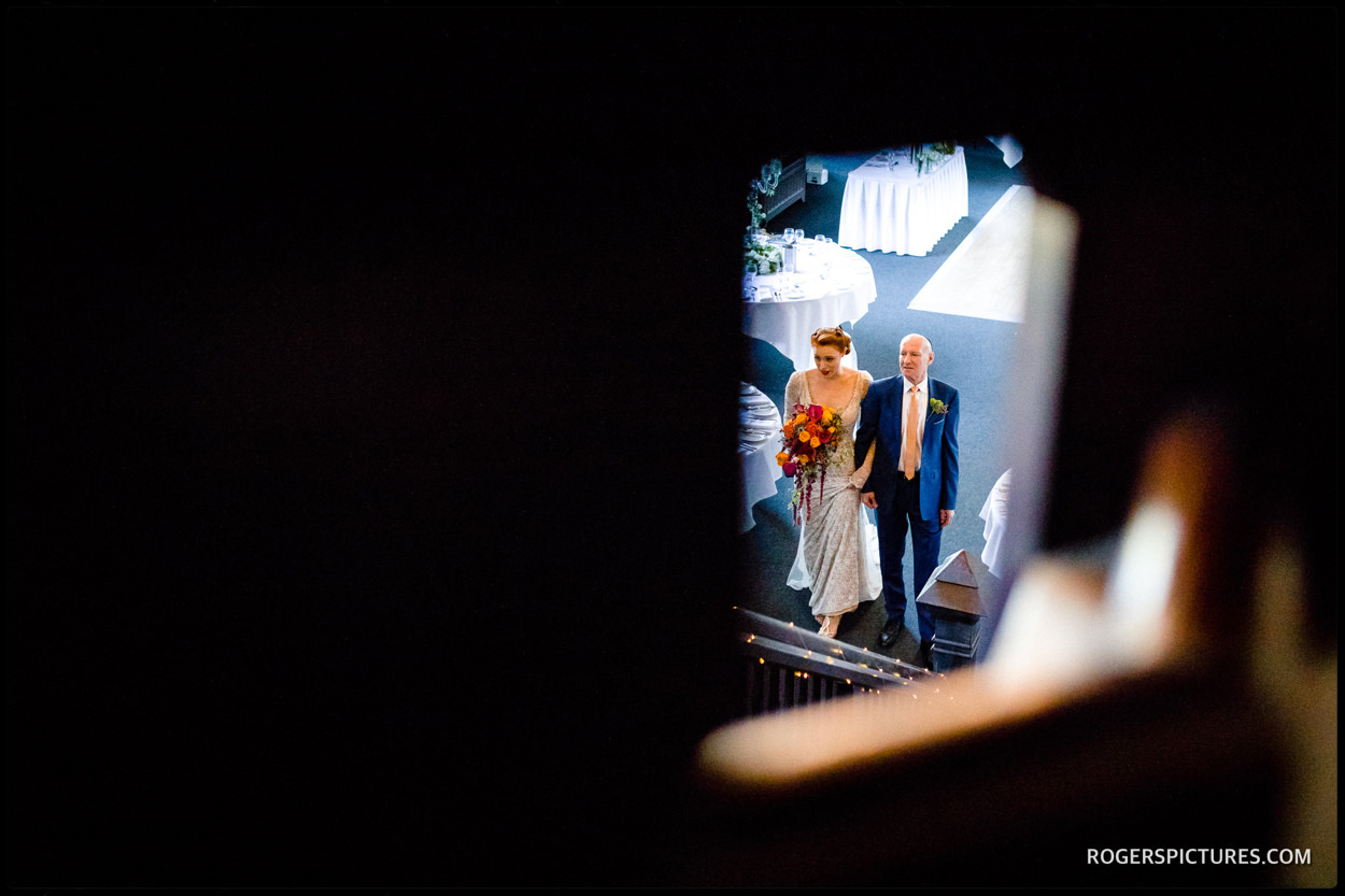 Bride and Father in the barn at Essendon Country Club wedding