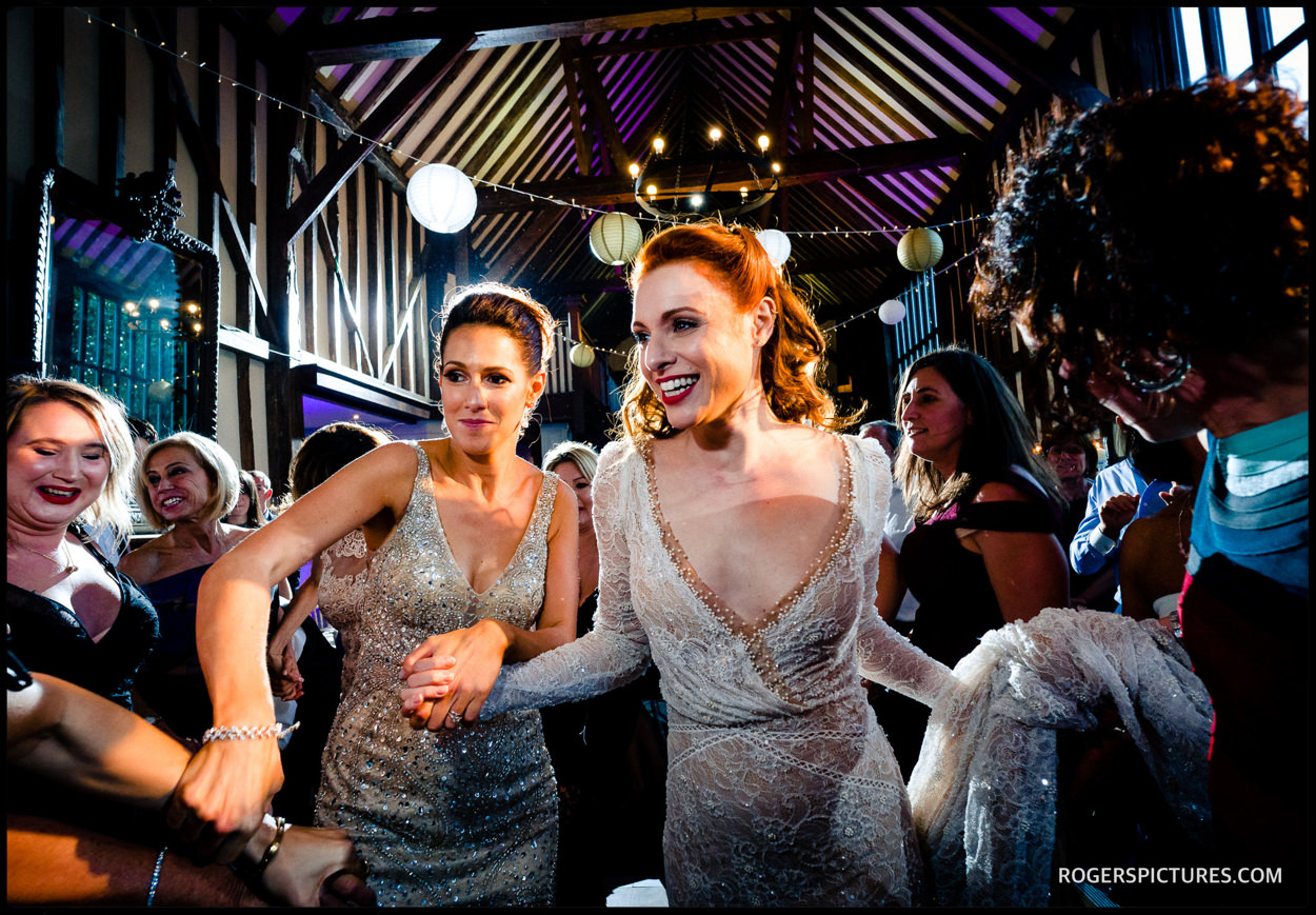 Bride and sister dancing at Essendon Country Club wedding
