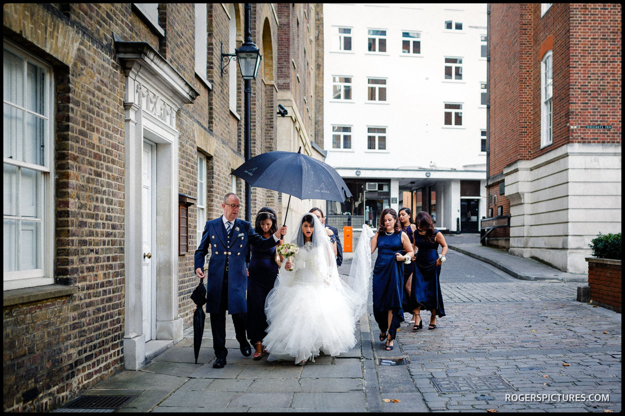 Bridal party walk to Temple Church for a wedding
