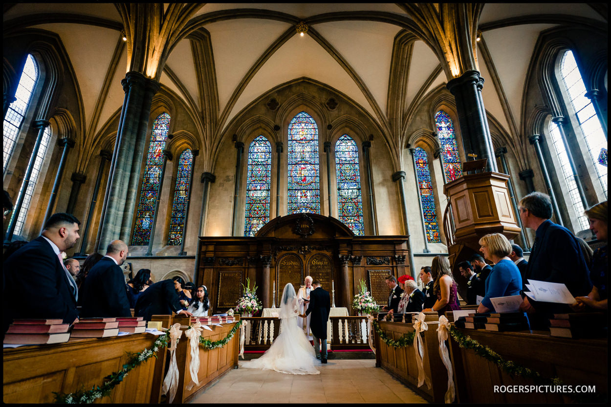 Wide photo of a wedding at Temple Church in London