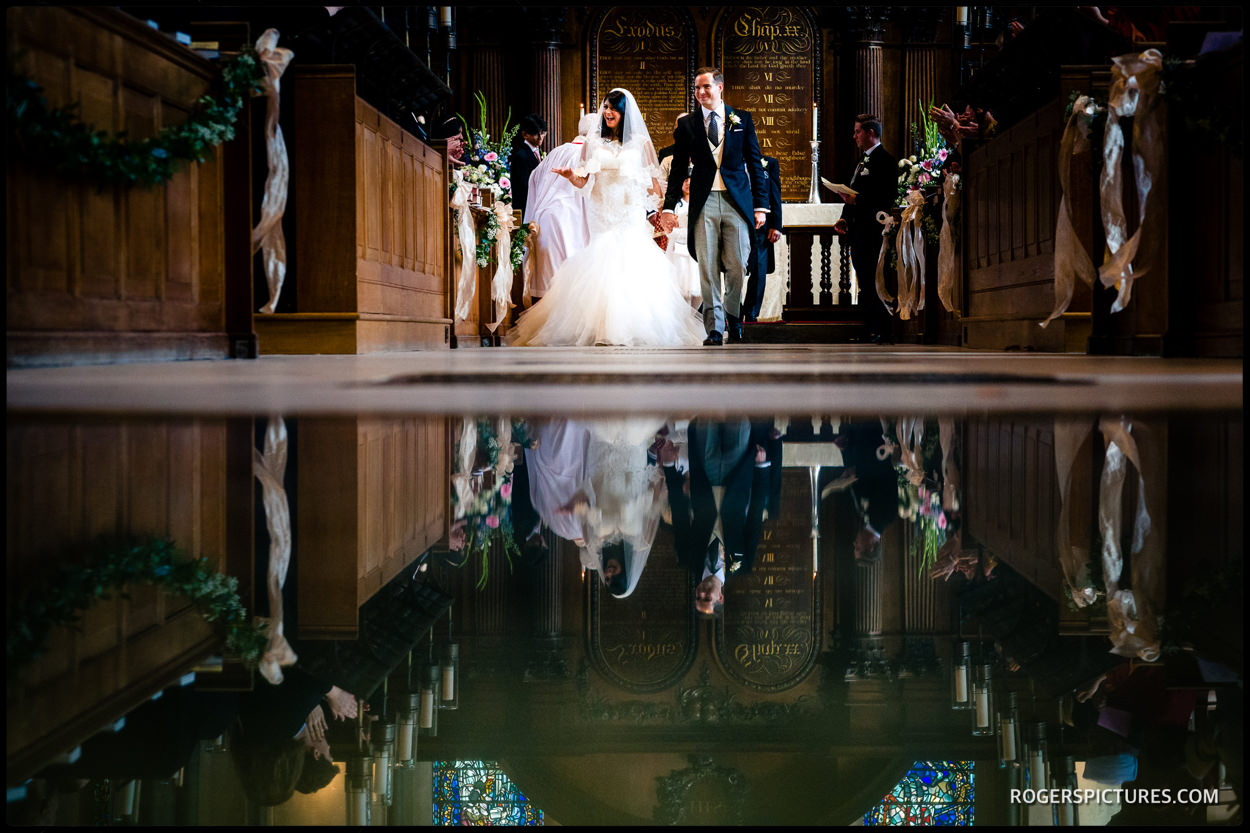 Temple church newly married couple walk down the aisle