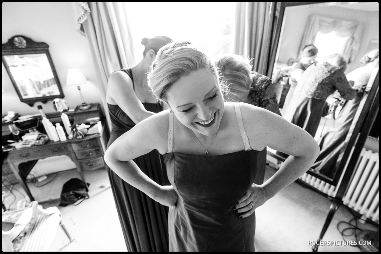 Bride prepares at North Cadbury Court wedding in Somerset