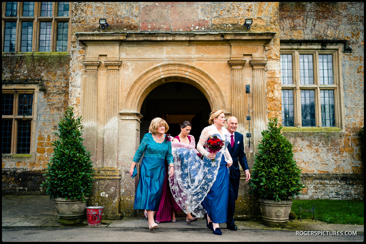 Bride and bridesmaids leave at North Cadbury Court on their way to the ceremony