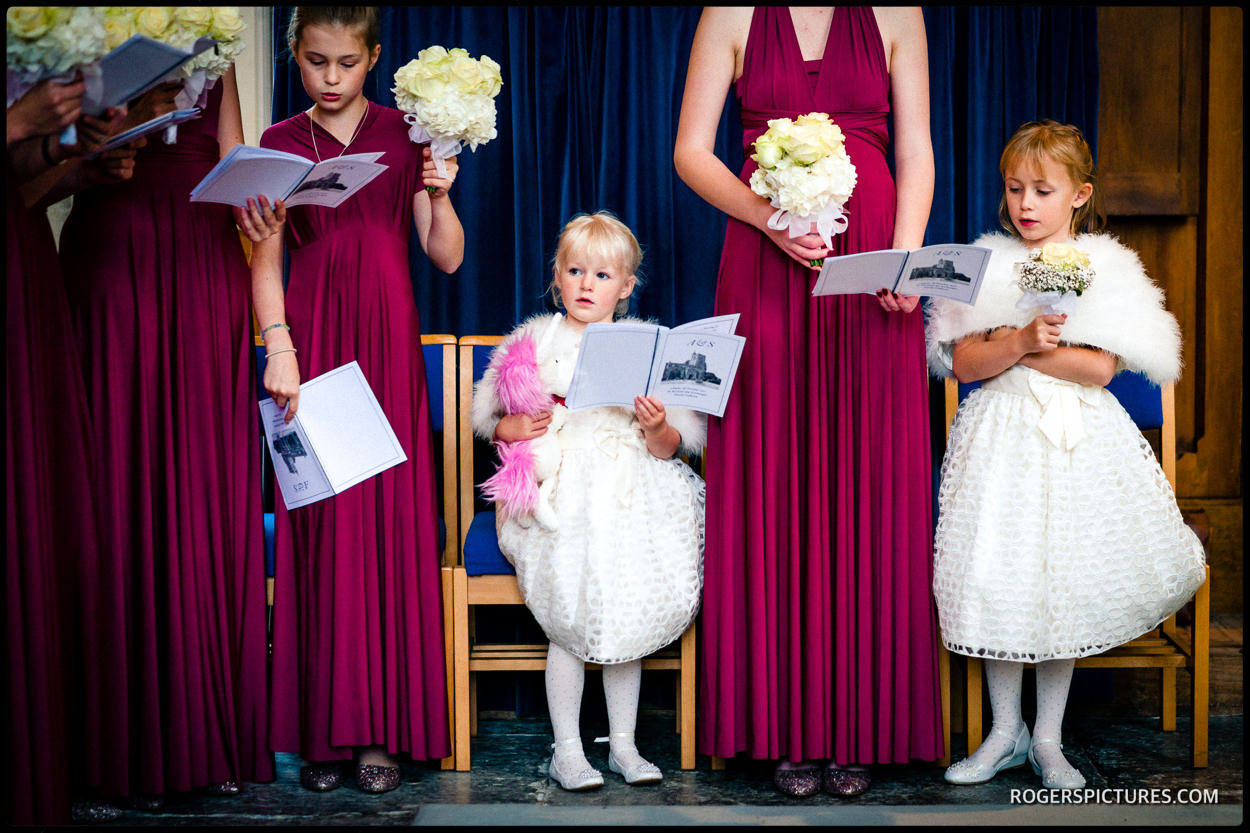 Purple bridesmaids dresses at a wedding in a church