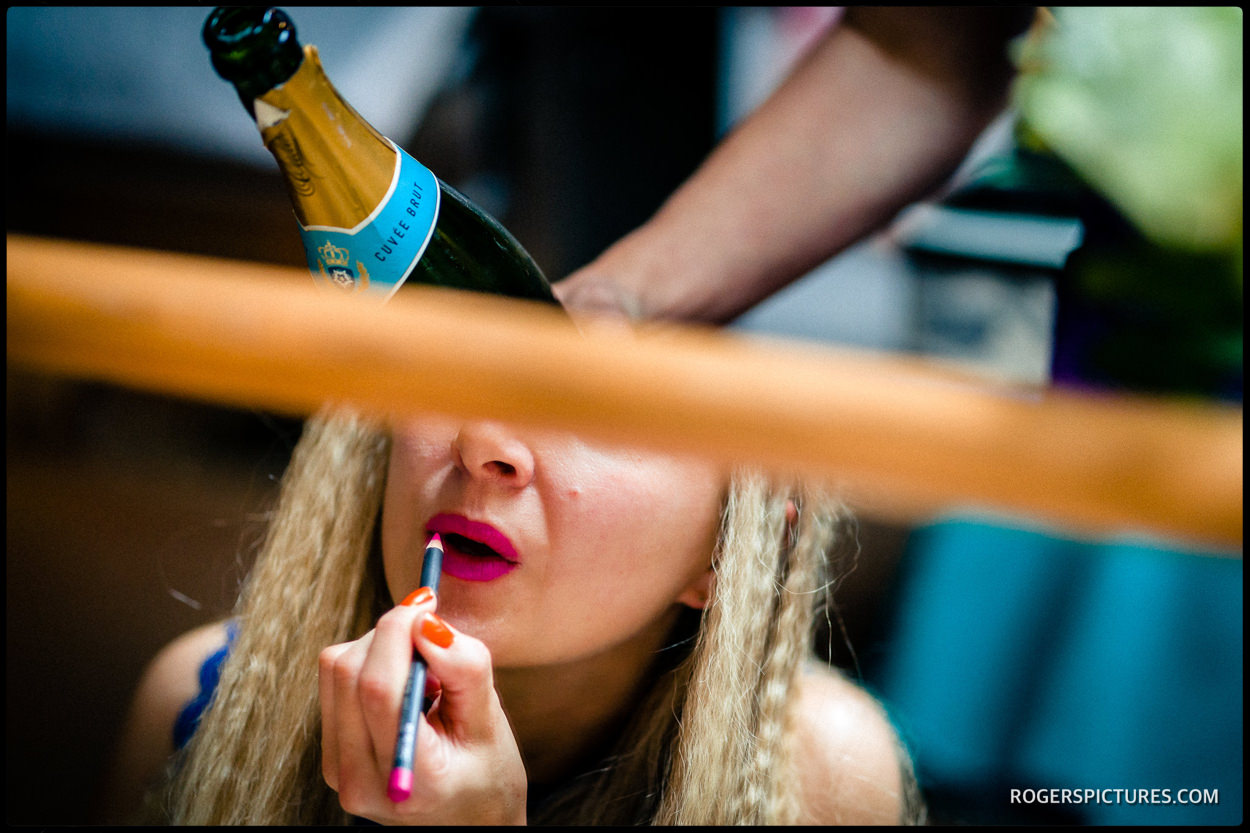 Make up and champagne at a London wedding preparations