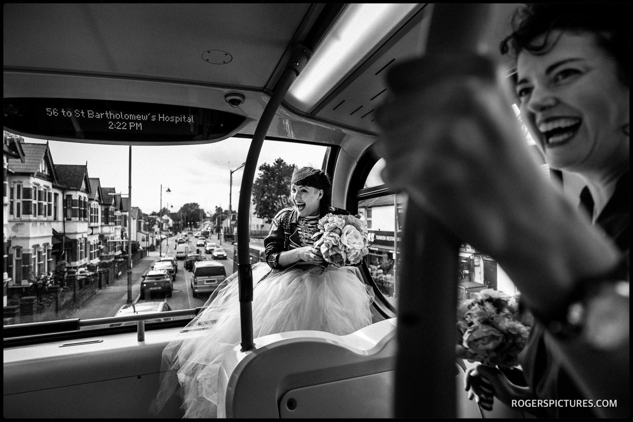 Bride o her way to a wedding on a bus from Walthamstow