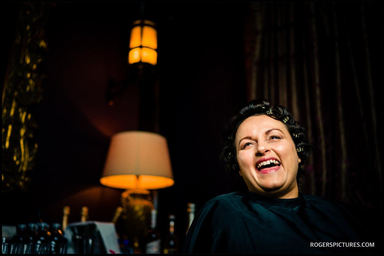 Laughing bride before her Chelsea wedding
