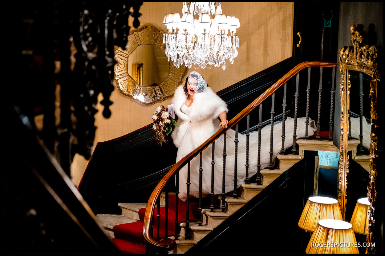 Bride leaving The Gore hotel for her wedding at Chelsea Town Hall