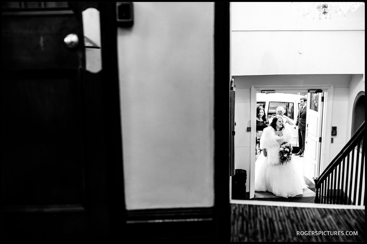Documentary photo of bride arriving at Chelsea Town Hall