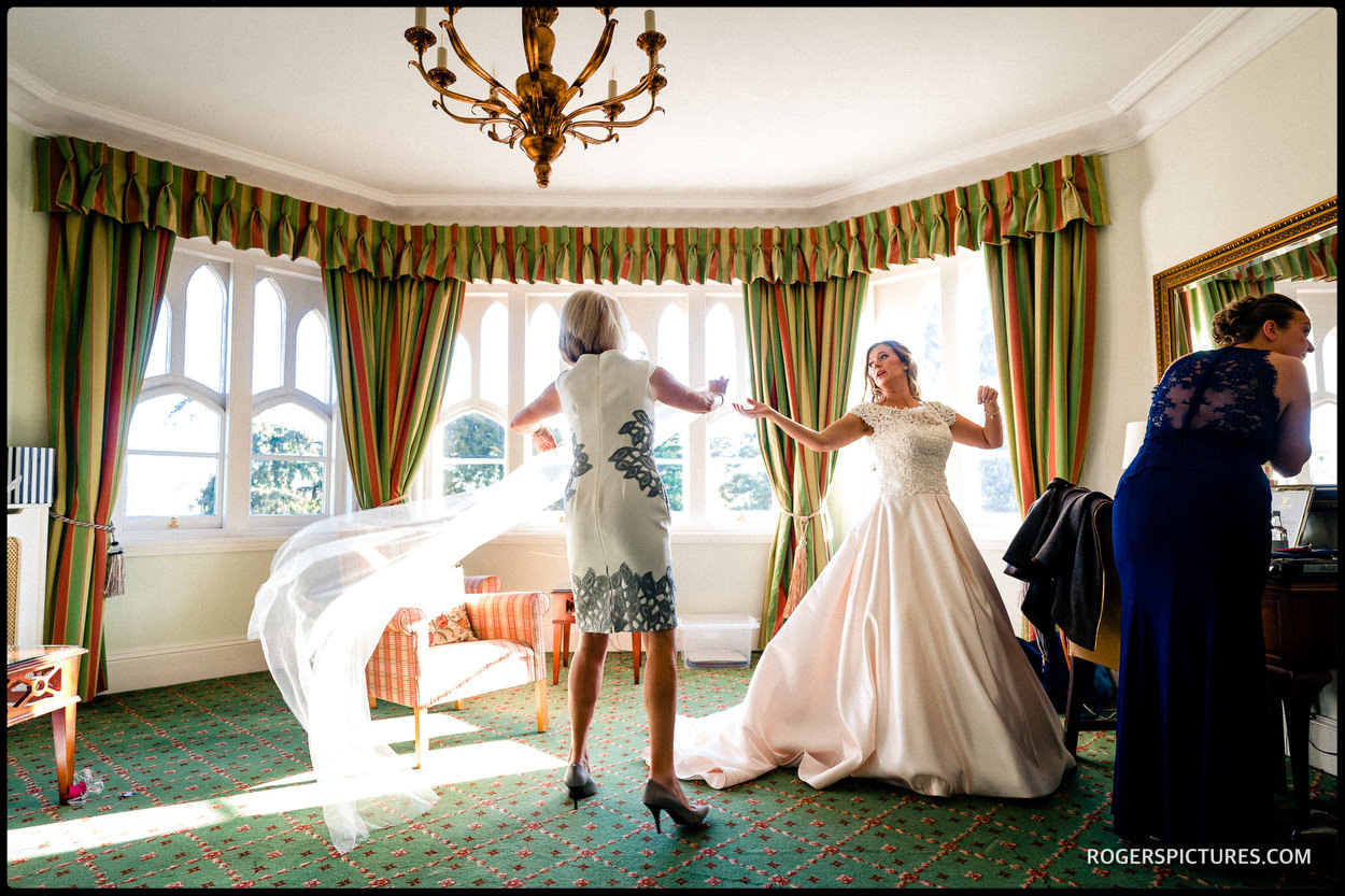 Bride getting ready at Oakley Court Windsor Berkshire