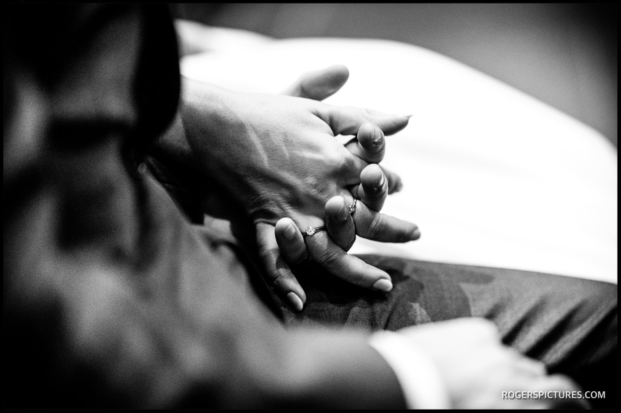 Couple holding hands during a church marriage