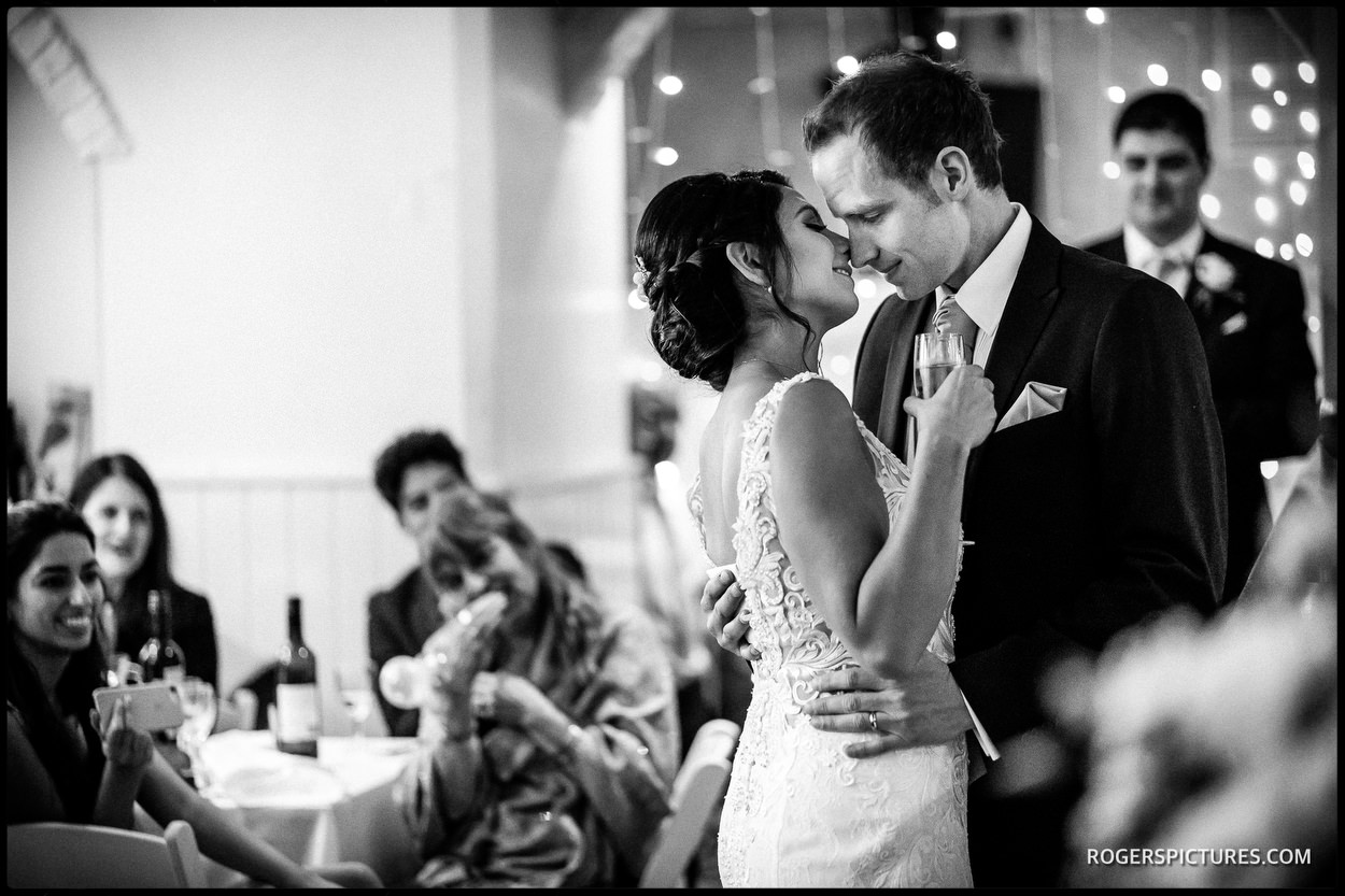 Unposed moment between bride and groom at a London wedding