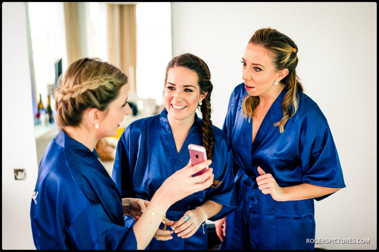 Bridesmaids in blue silk dressing gowns
