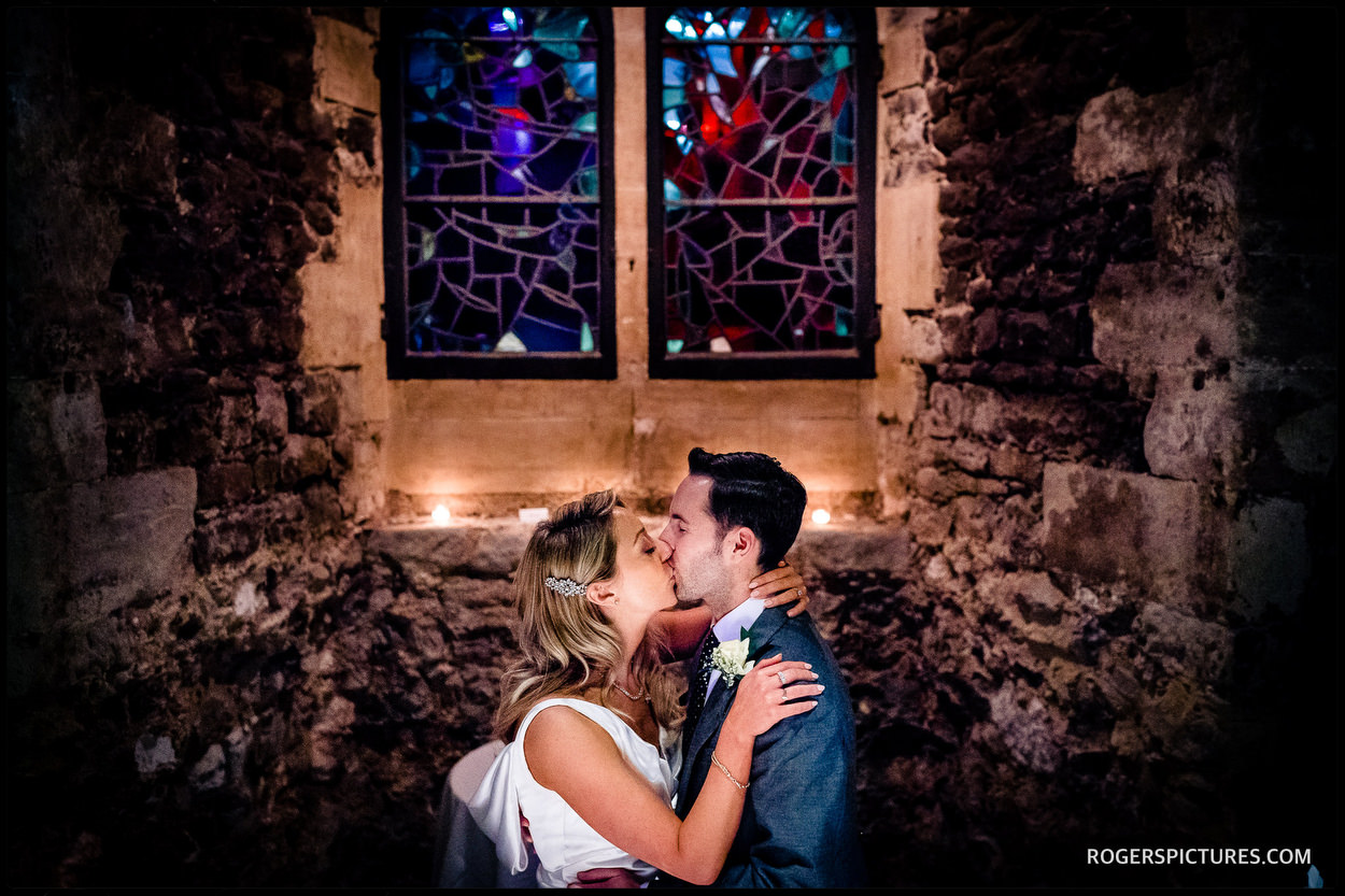New weds kiss at The Crypt at Ely Place