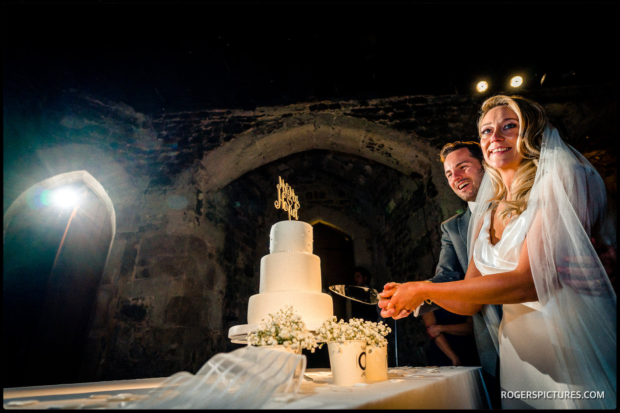 Wedding cake cutting at The Crypt at Ely Place