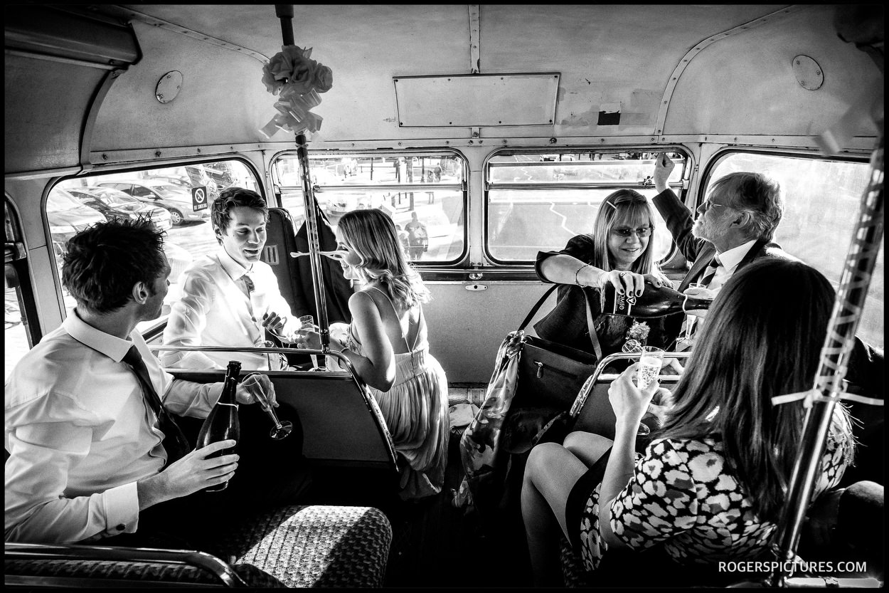 Wedding guests on a London Bus on their way to The fable