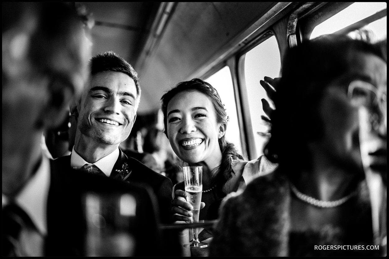 Married couple on London Bus after wedding at Islington Town Hall