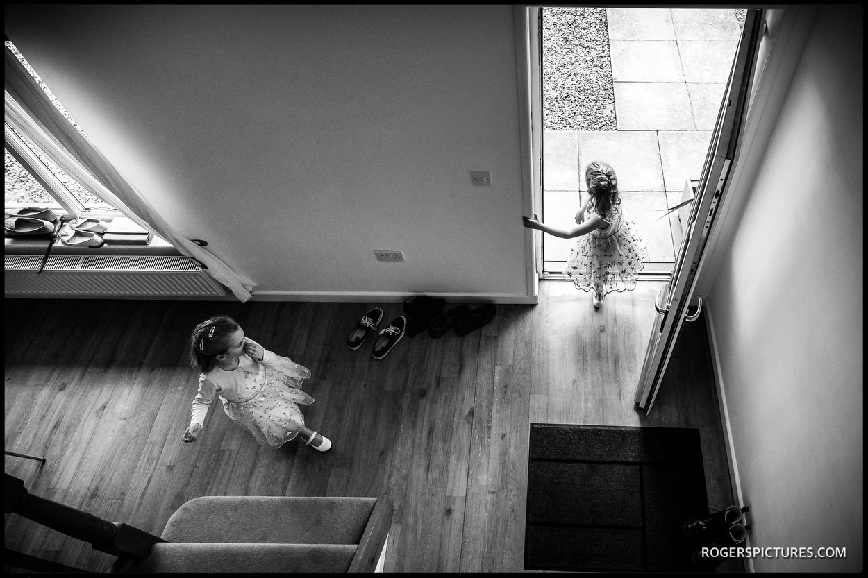 Flowergirls playing before the wedding ceremony