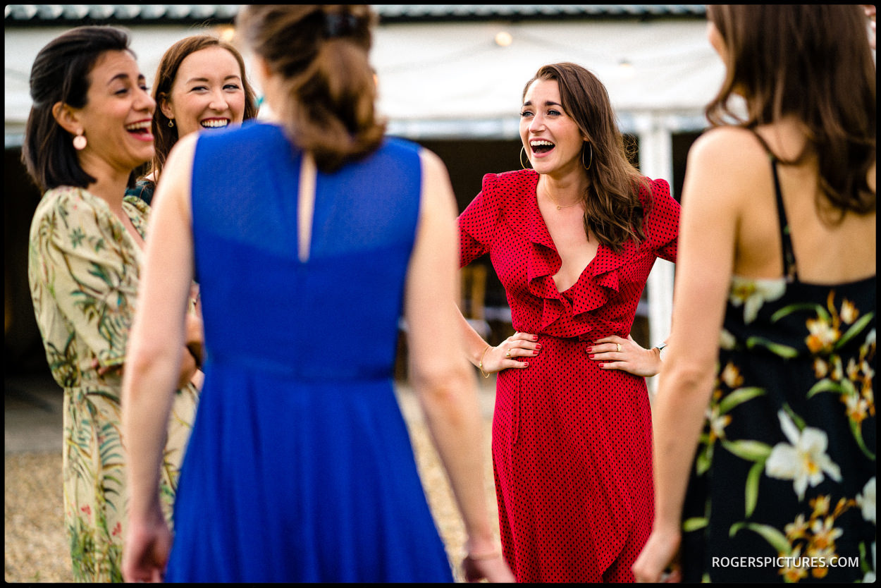 Wedding guest in a red dress