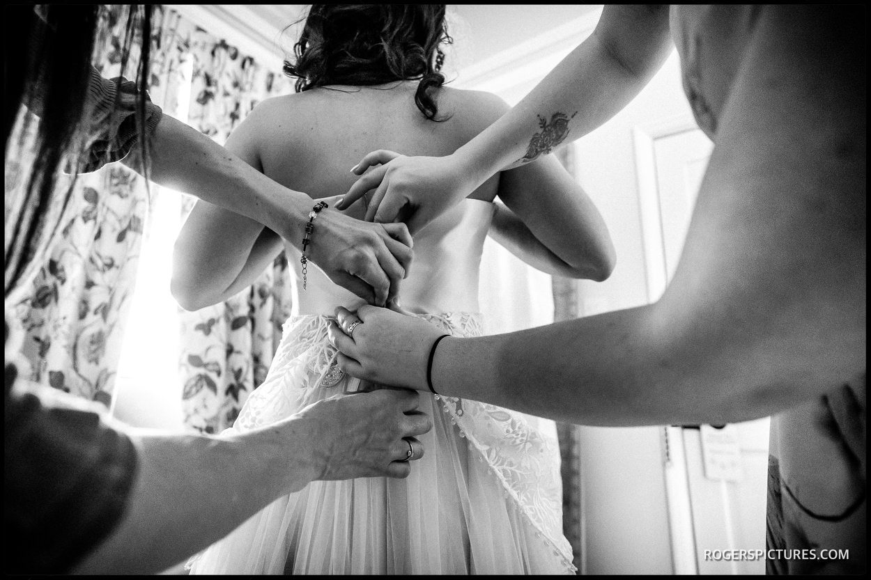 Wedding dress being done up in black and white
