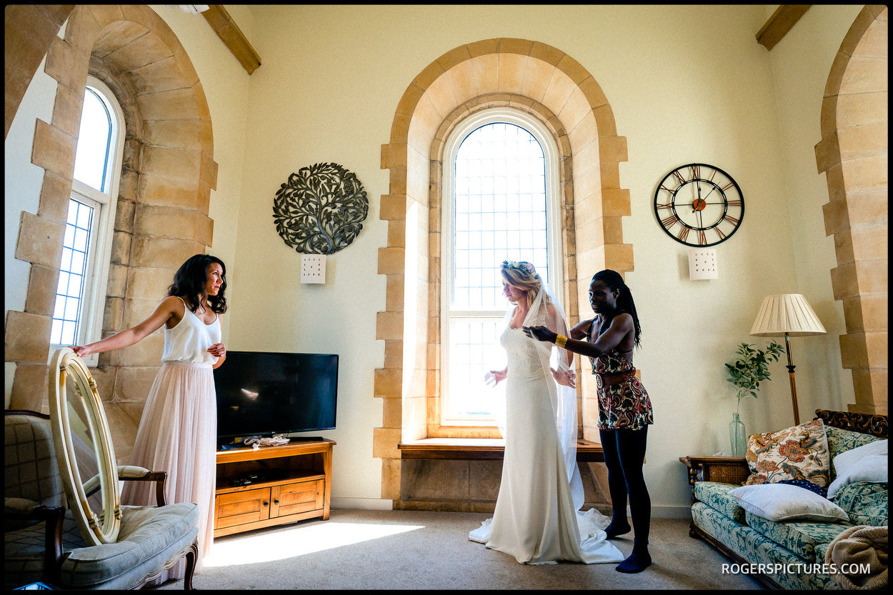 Bride and bridesmaids getting ready in Thorpness, Suffolk